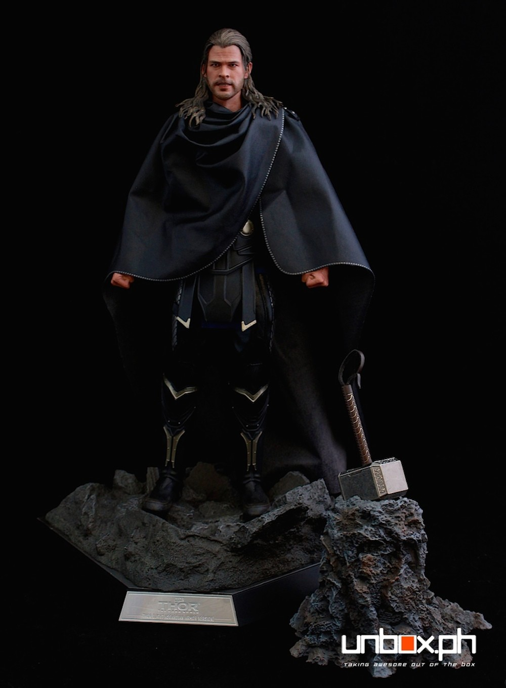 Together with the hammer and rock from the first Thor figure.