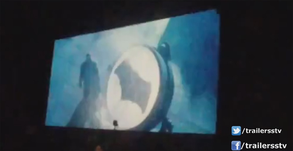 Batman is seen opening up the Bat-Signal (most likely on top of Gotham).