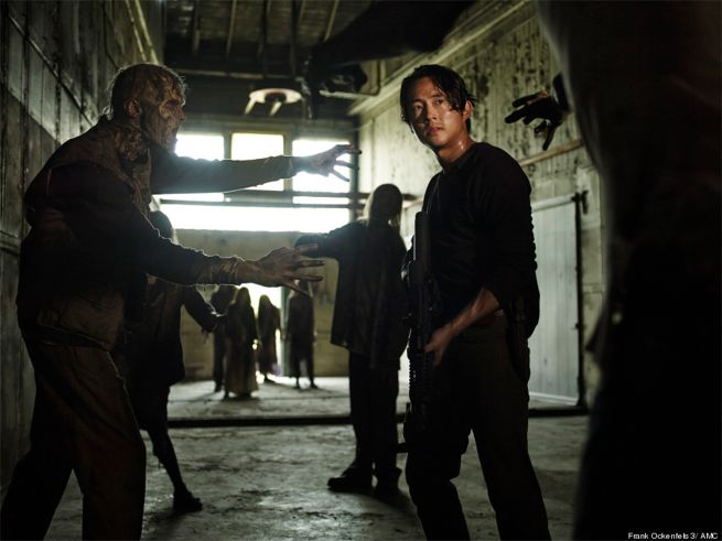 Glenn Rhee (Steven Yeun) prepares to face off against a group of walkers in Season 5. Photo by AMC.