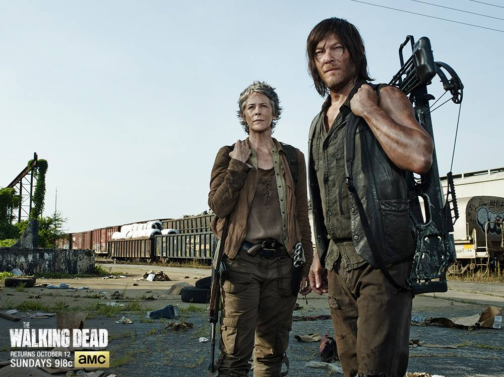 Daryl Dixon (Norman Reedus) and Carol Peletier (Melissa McBride) look onward at the distance in this screenshot from Season 5. Photo by AMC.